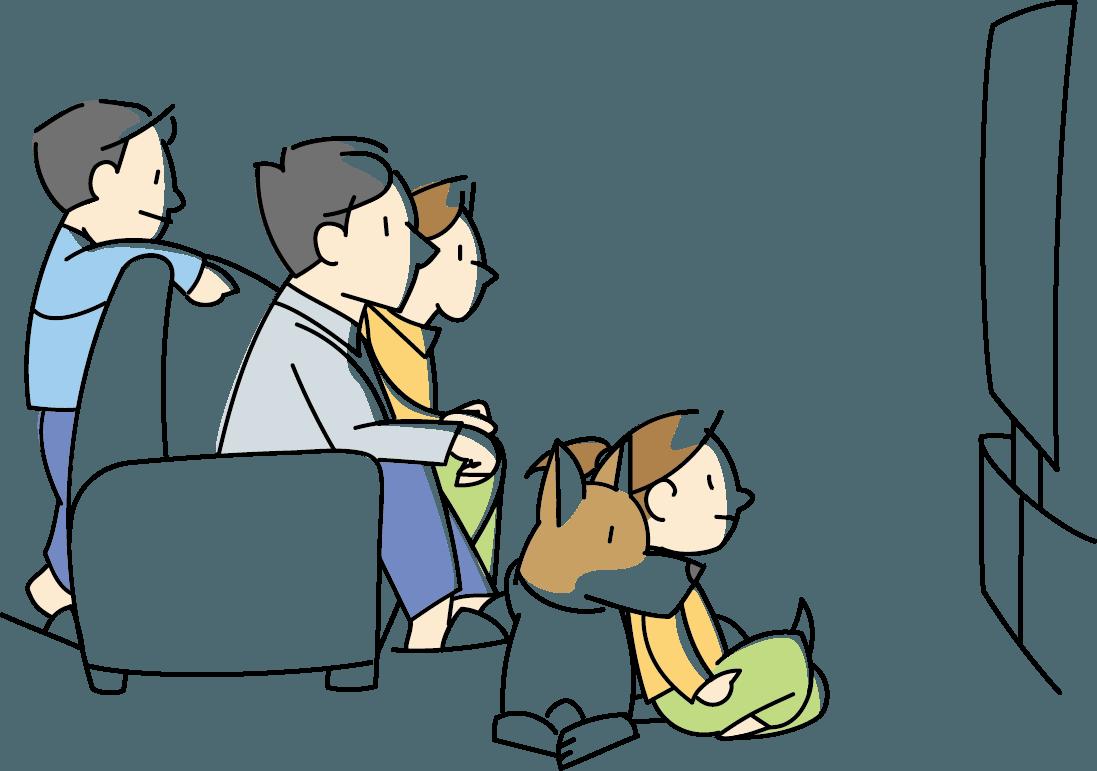 ホームシアターで映画を観る家族